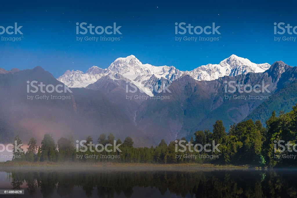 Mount Cook in Lake Matheson New Zealand stock photo