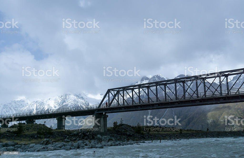 Mount Cook One Person Crosses Bridge stock photo