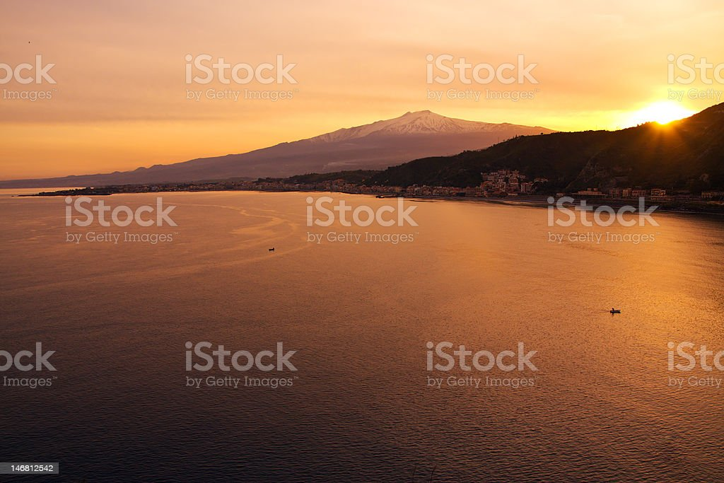 Mount Etna by the sea from Taormina at sunset royalty-free stock photo