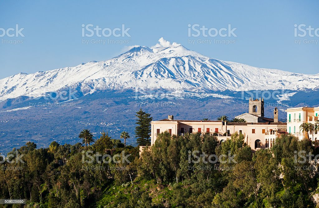 Mount Etna, Sicily, Italy, seen from the town of Taormina. stock photo