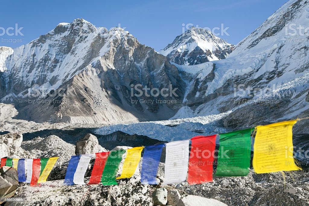 Mount Everest base camp with row of buddhist prayer flags stock photo