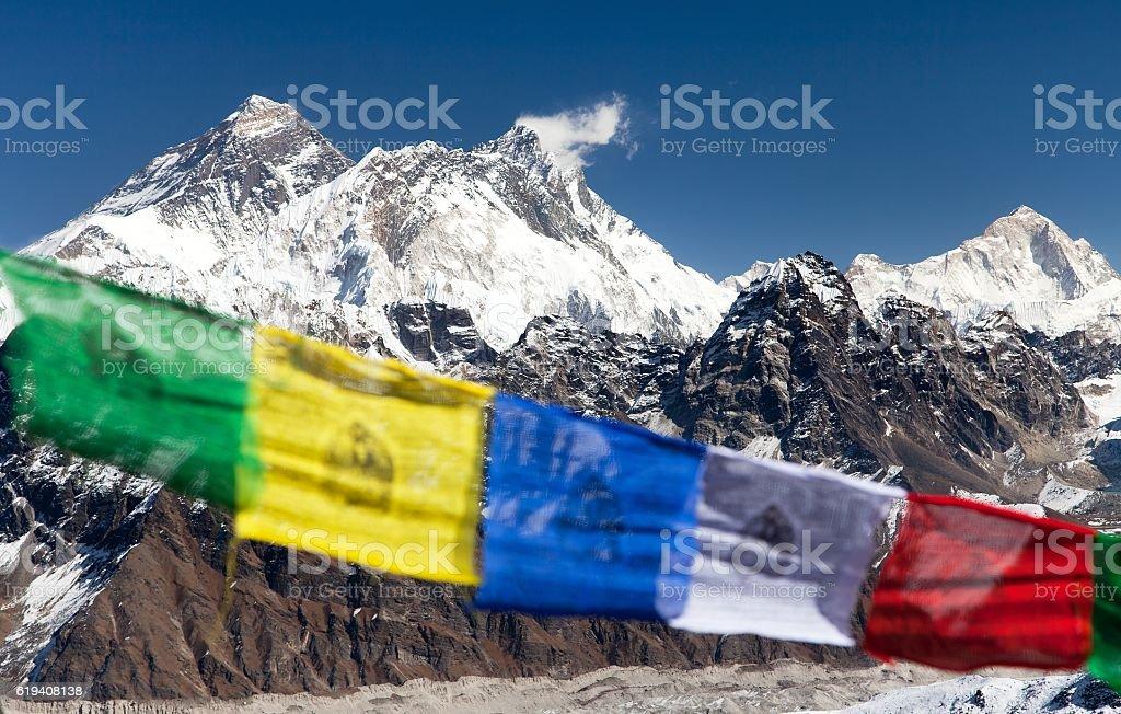Mount Everest, Lhotse and Makalu with buddhist prayer flags stock photo