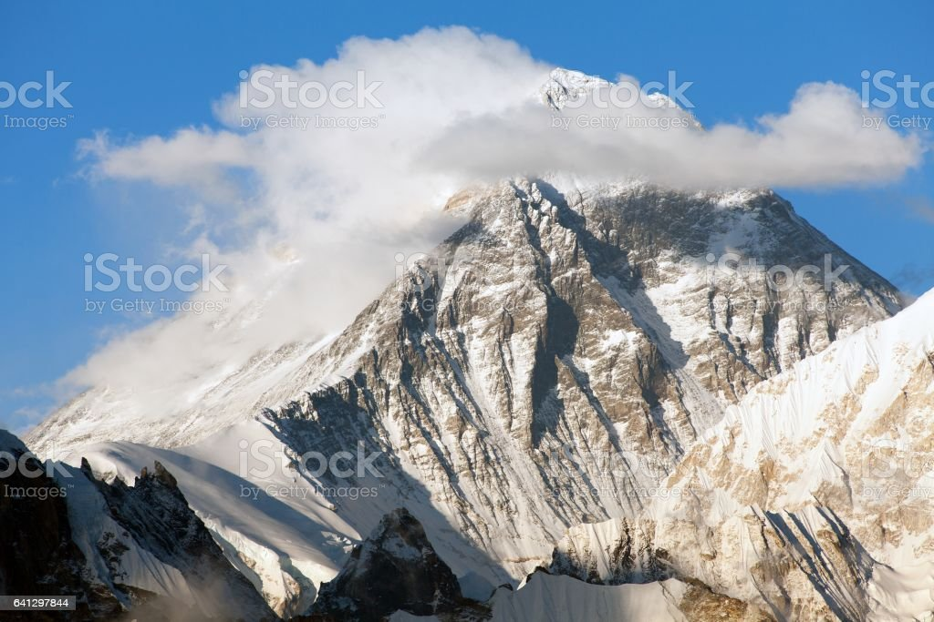 mount Everest with beautiful clouds on the top stock photo