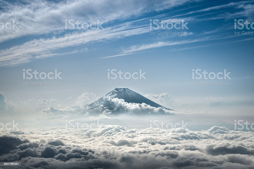 Mount Fuji rising above the clouds stock photo