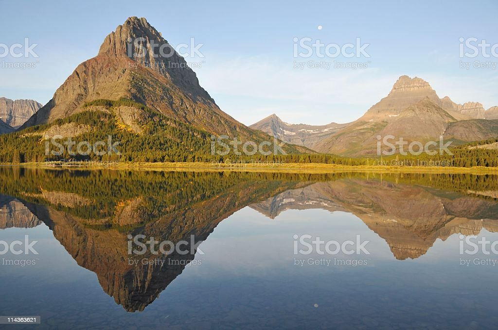 Mount Grinnel reflected in Swiftcurrent Lake stock photo