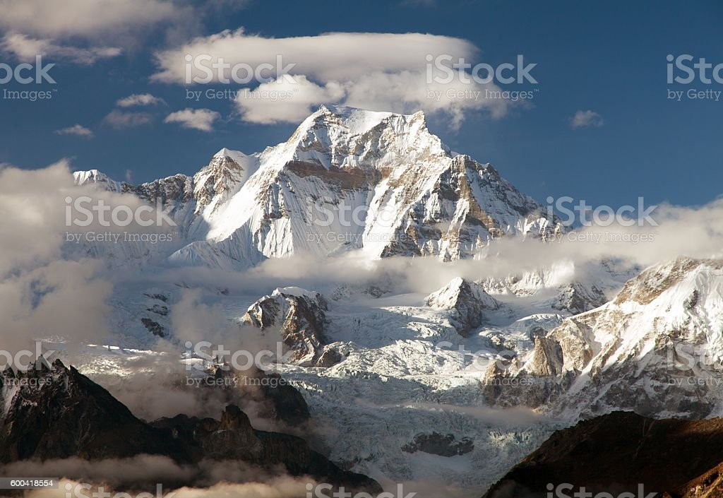 mount Gyachung Kang 7952m within clouds stock photo