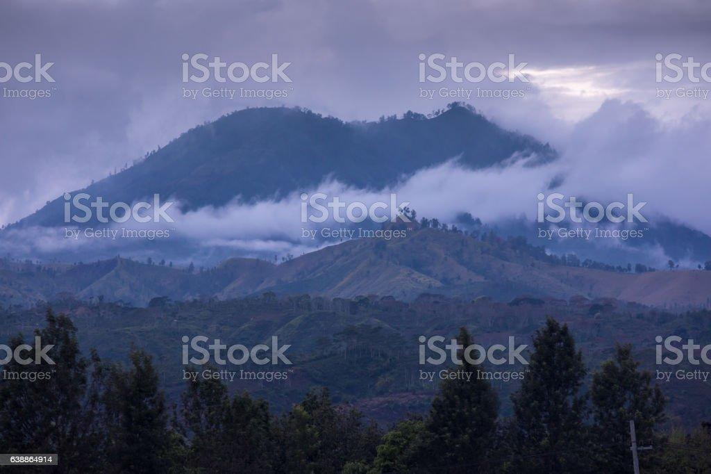 Mount Kawah Ijen volcano during sunrise in East Java, Indonesia. stock photo
