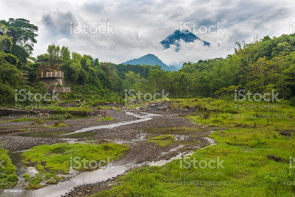 Mount Merapi among the clouds stock photo