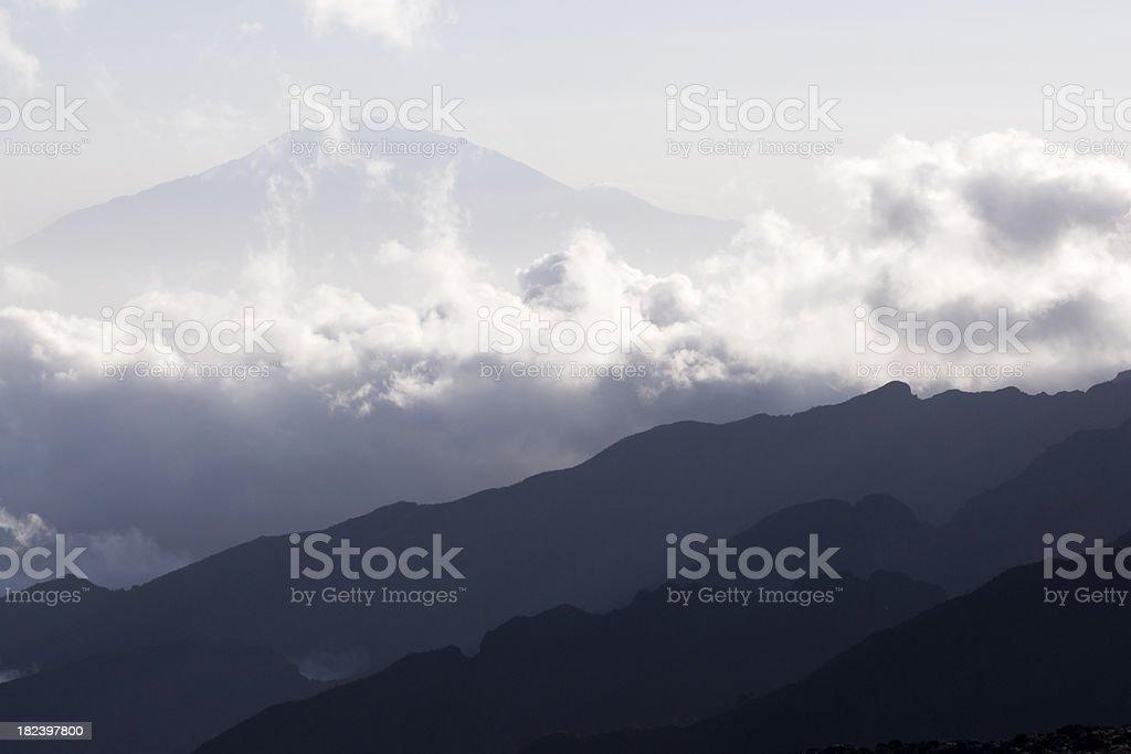 Mount Meru and layerd mountains, slopes of the Kilimanjaro stock photo