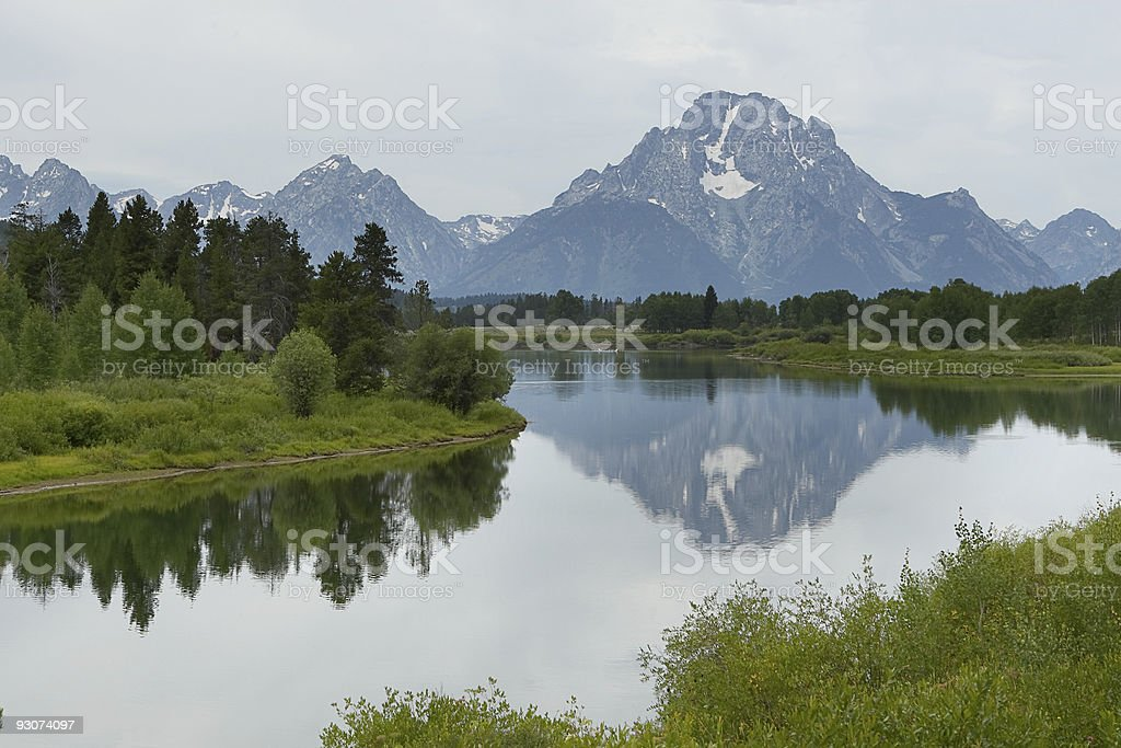 Mount Moran reflected in the Snake river royalty-free stock photo