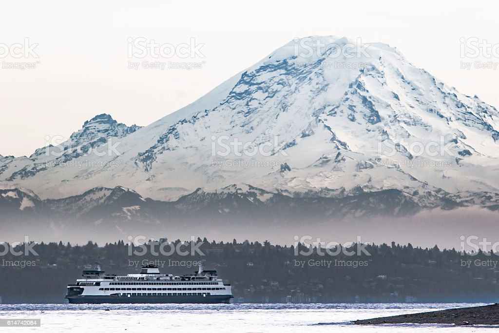 Mount Rainier Looms over Ferry on Puget Sound stock photo
