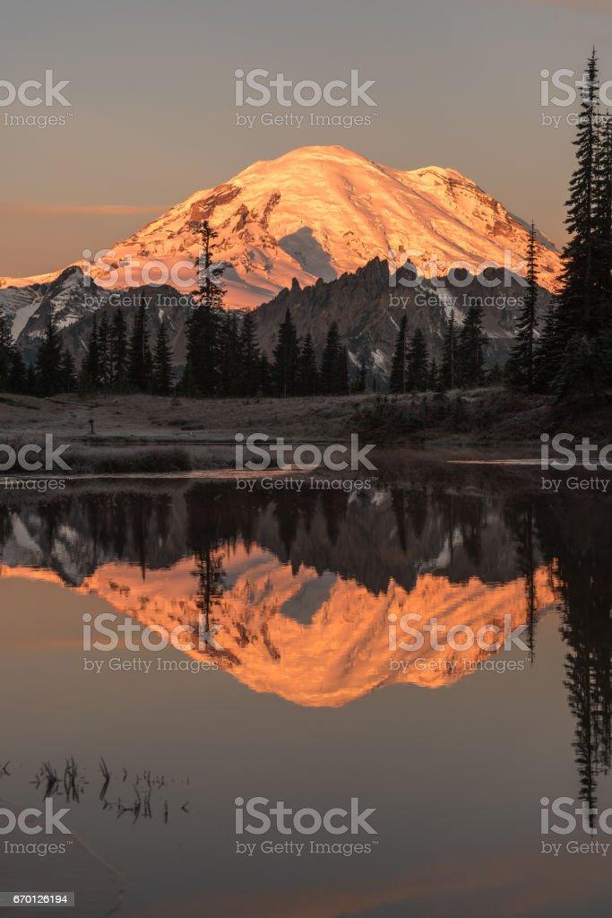 Mount Rainier reflects in Upper Tipsoo Lake stock photo