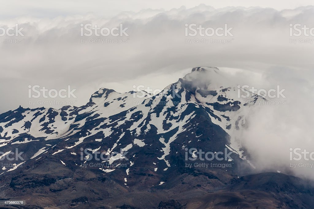 Mount Ruapehu covered in clouds stock photo