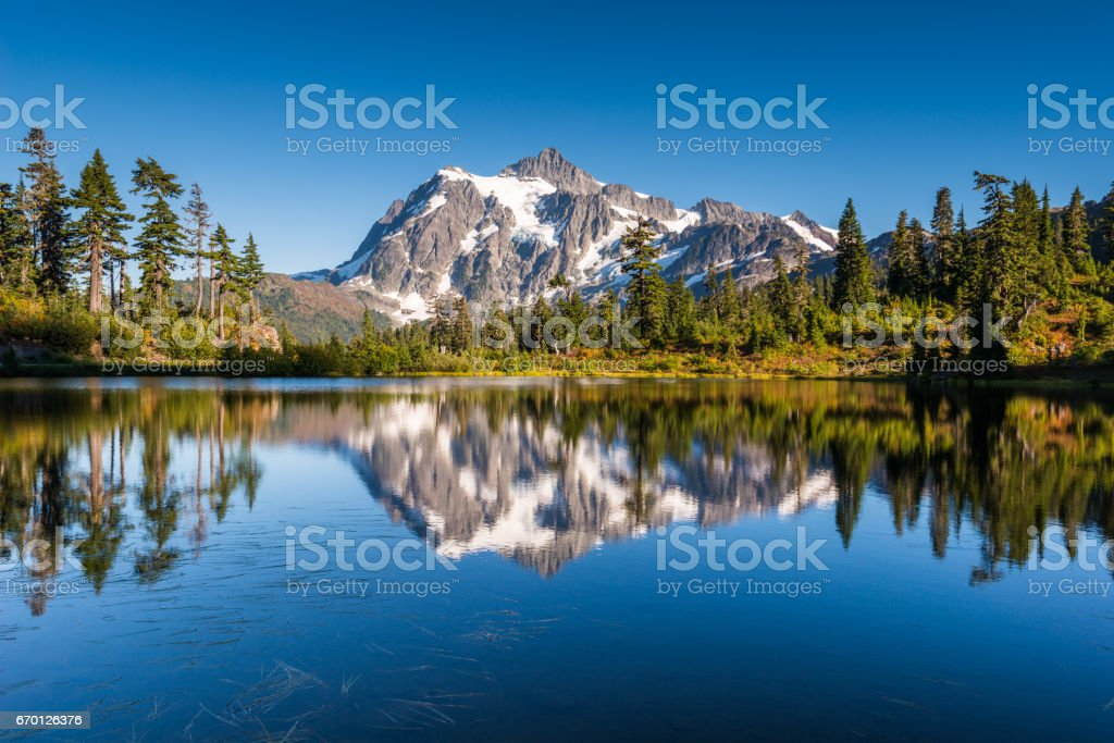 Mount Shuksan reflects in Picture Lake stock photo