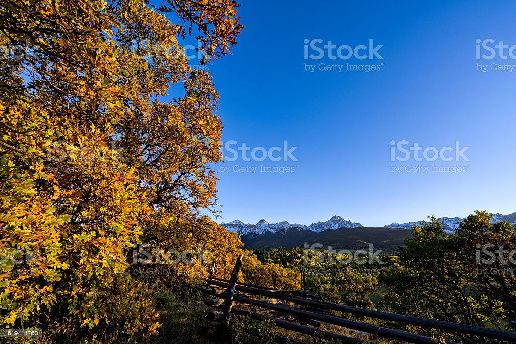 Mount Sneffels and Old Fence at Sunset stock photo