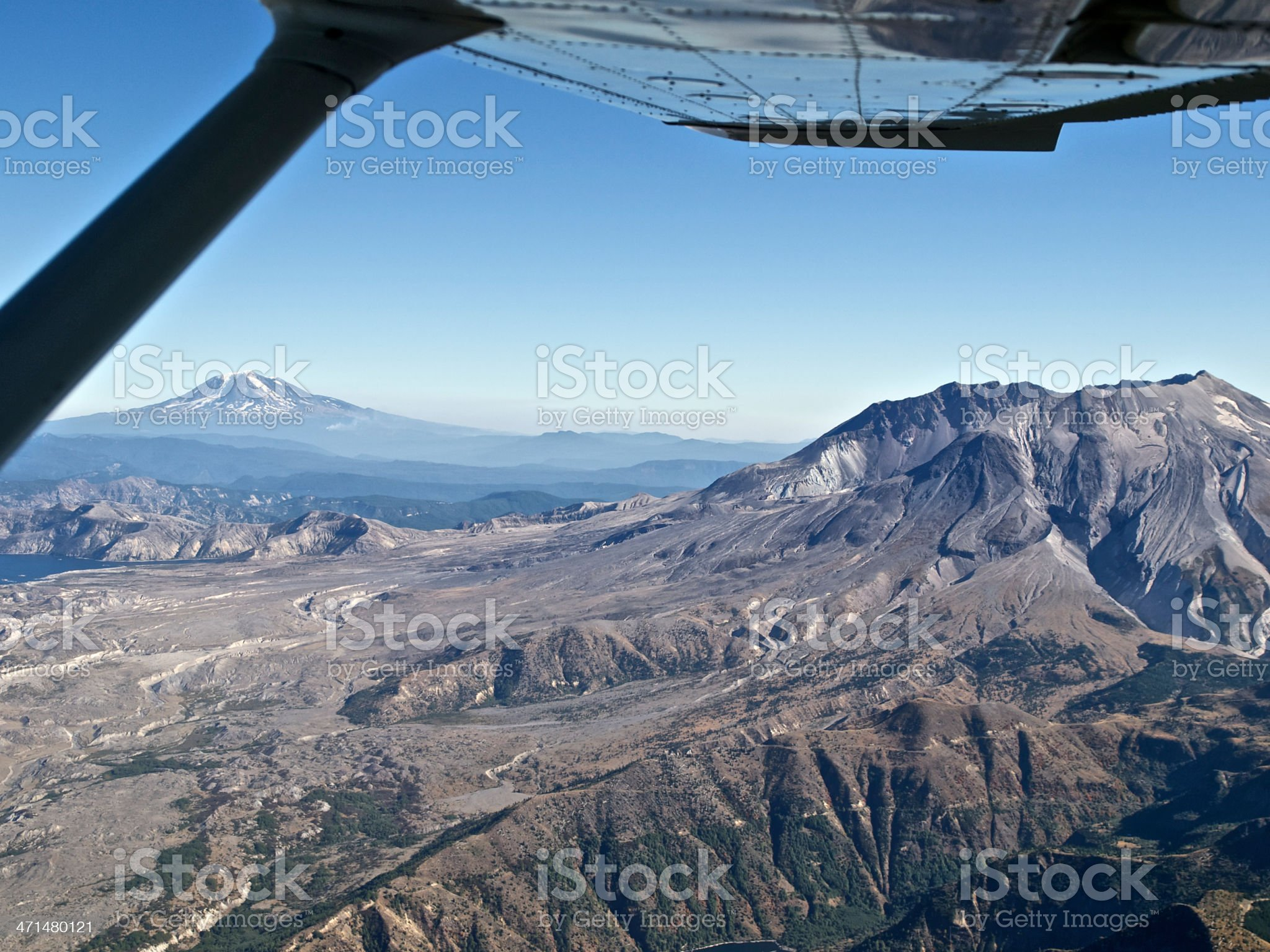 Mount St Helens and Mt Rainier Aerial October Airplane Wing royalty-free stock photo