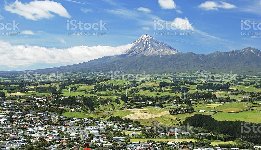 Mount Taranaki, in New Zealand, from afar on daylight stock photo