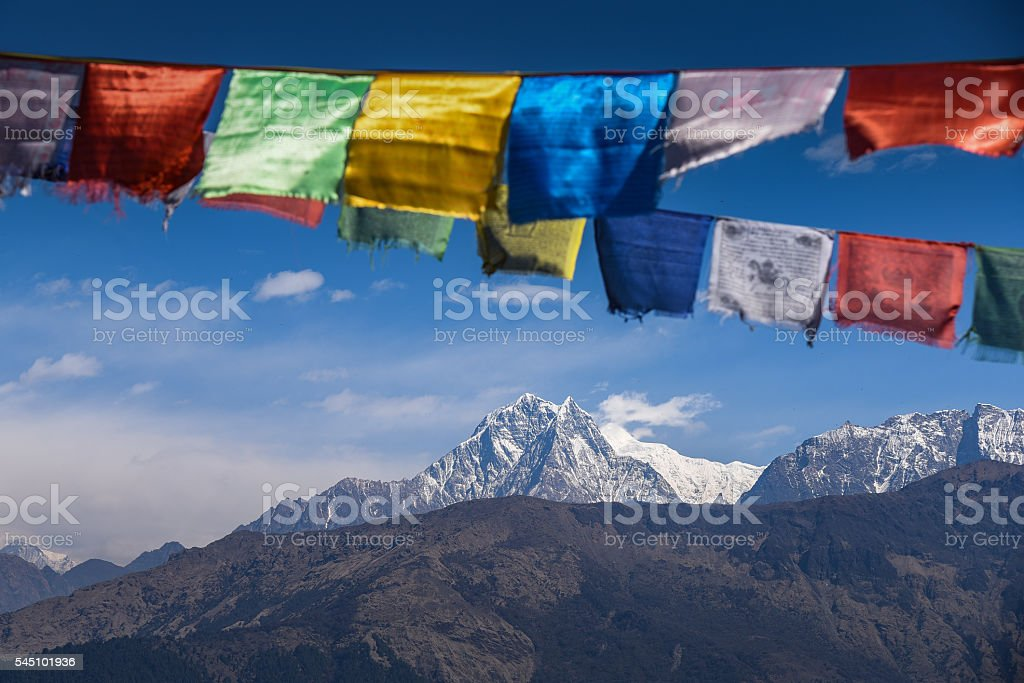 Mountain and Buddhist prayer flags in Nepal stock photo