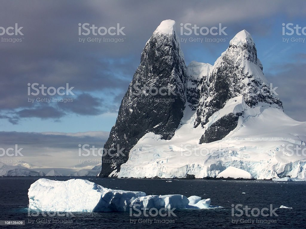 Mountain and Icebergs in Lemaire Channel, Antarctica stock photo