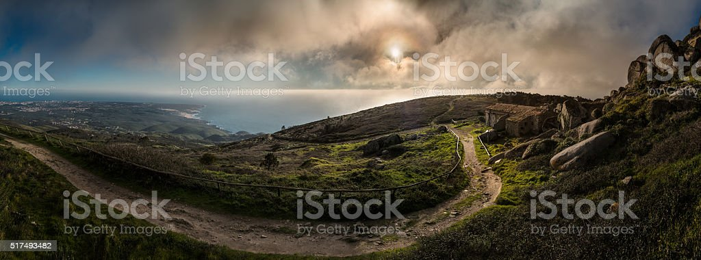 Mountain and ocean view with cloudy sky at sunset stock photo