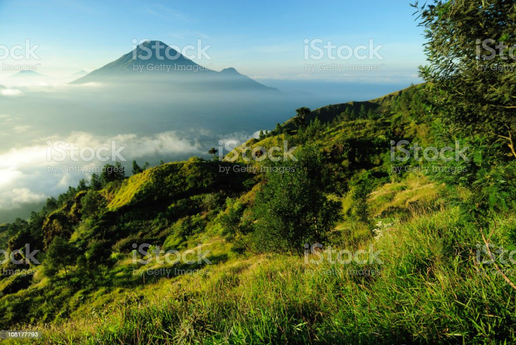 Mountain and volcano landscape in Indonesia at sunrise stock photo