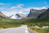 Mountain asphalt road surrounded by mountains, Norway