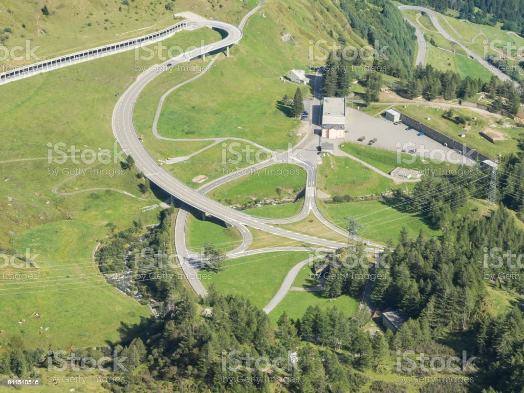 Mountain bends and intersections that create beautiful shapes. Road to Gotthard pass, Switzerland stock photo