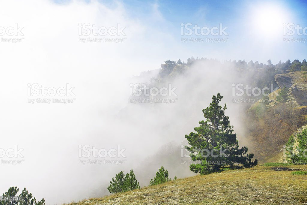 Mountain between clouds stock photo
