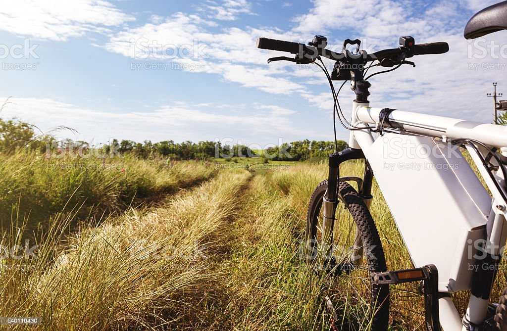 Mountain bicycle at sunny day on the dirt road stock photo