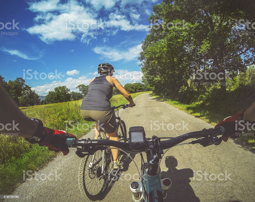 Mountain bicycle in group: on a road in Tuscany stock photo