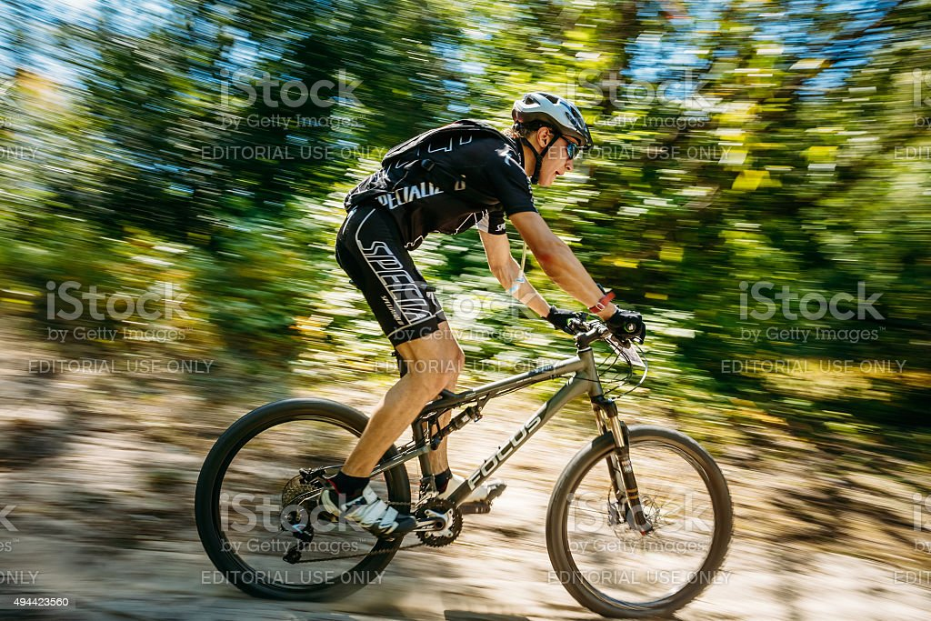 Mountain Bike cyclist riding track at sunny day, healthy lifesty stock photo