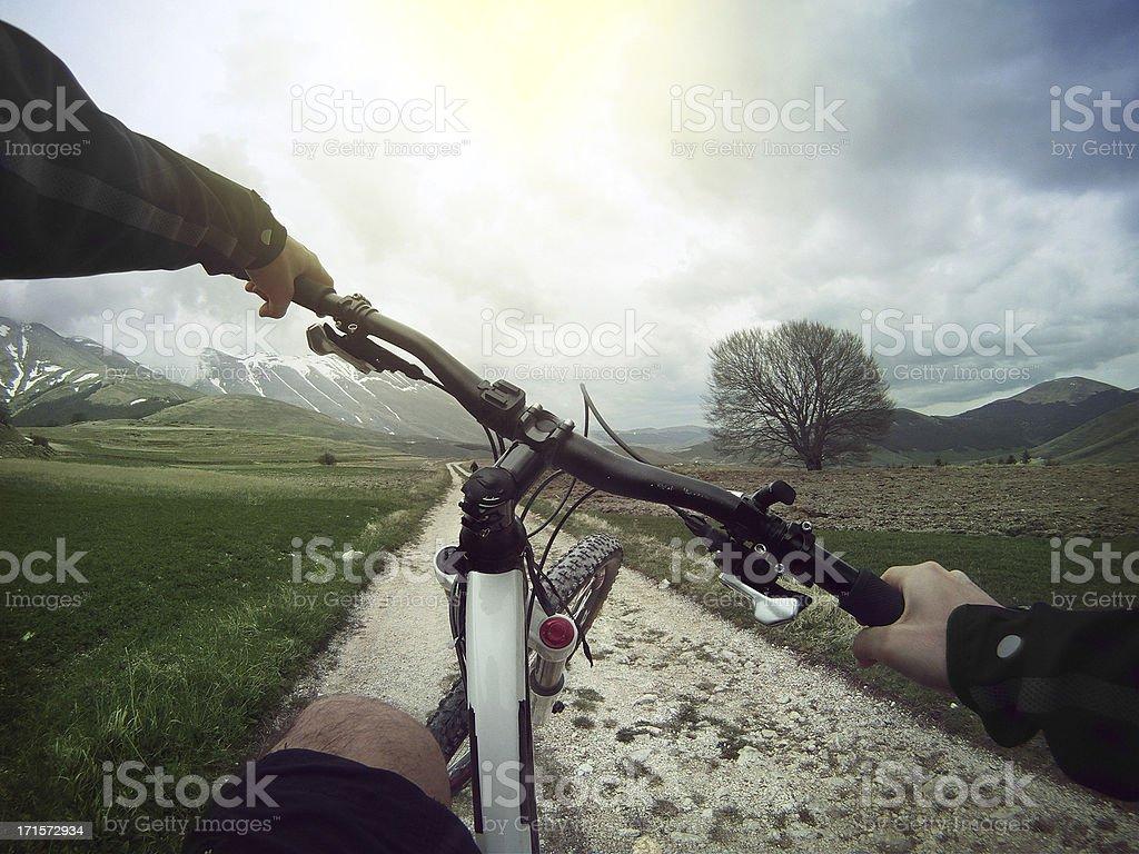 Mountain Bike: Eheeling on a White Road stock photo