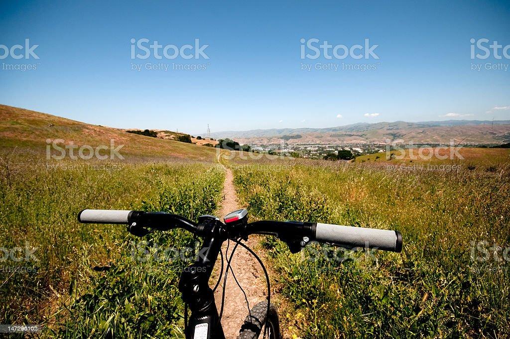 Mountain bike handle bars and trail stock photo
