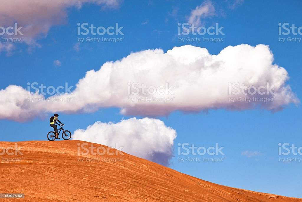 Mountain bike in Utah desert with clouds in background stock photo