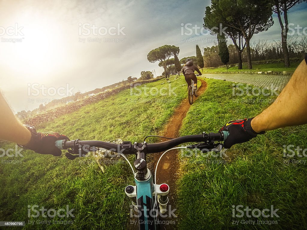 Mountain Bike on the Via Appia Antica and Aqueduct stock photo