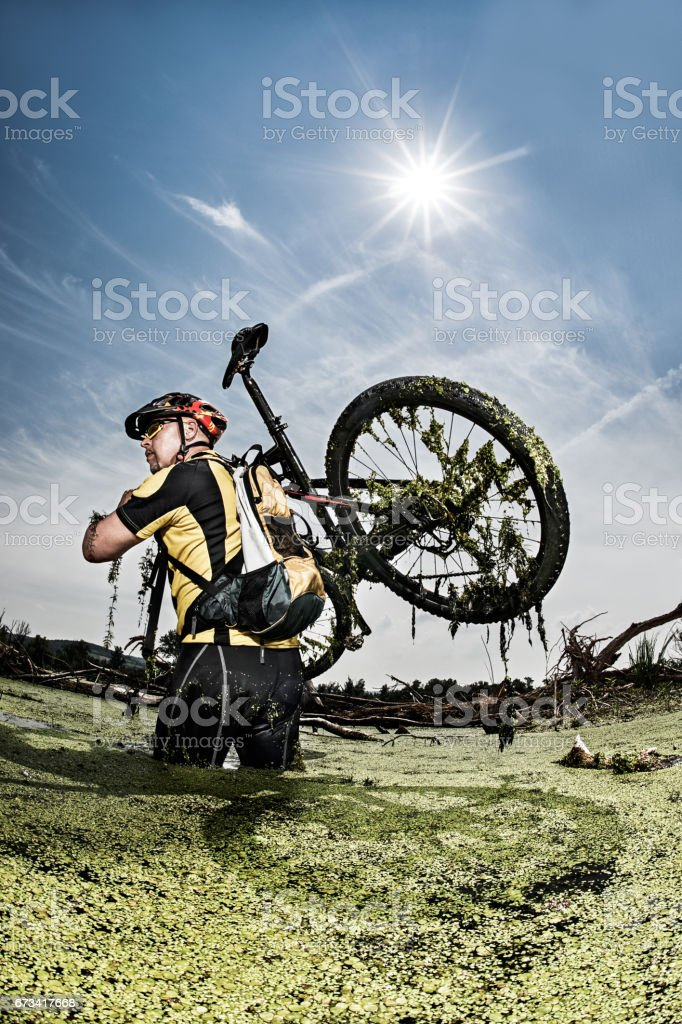 Mountain bike rider in the swamp stock photo
