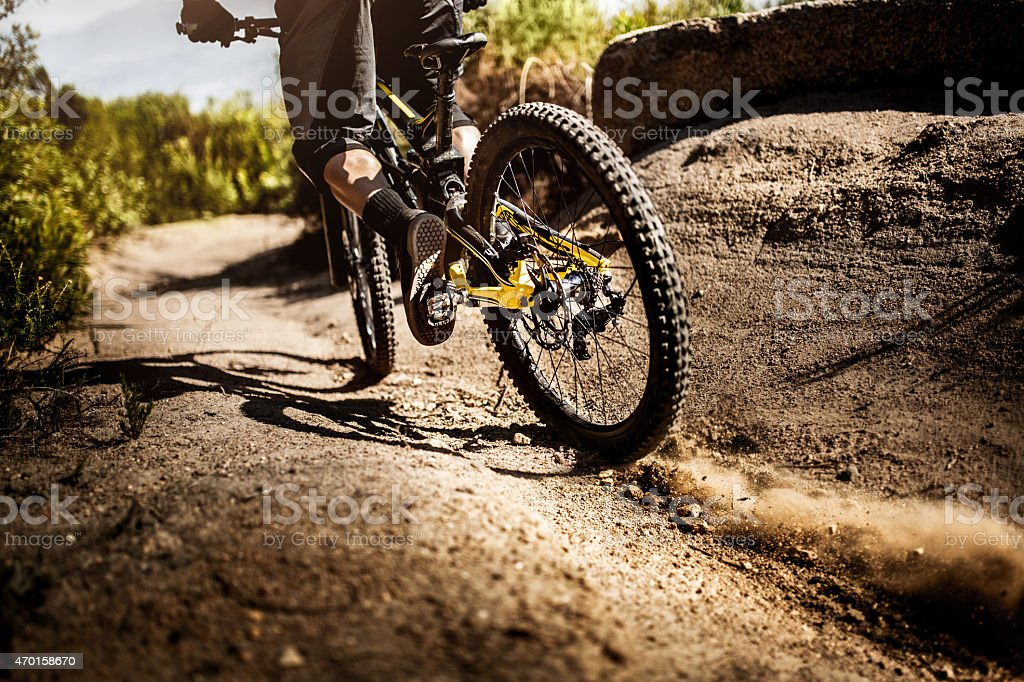 Mountain bike riding on dirt road showing it's tire tread stock photo
