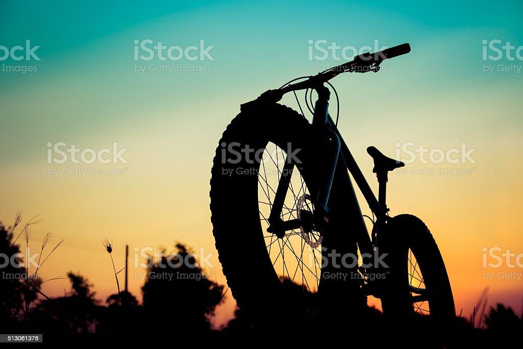 mountain bike silhouette on beautiful sunset, silhouette fatbike stock photo