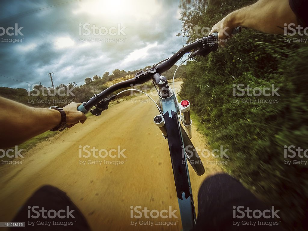 Mountain Bike: Weheeling on a Dirt Road stock photo