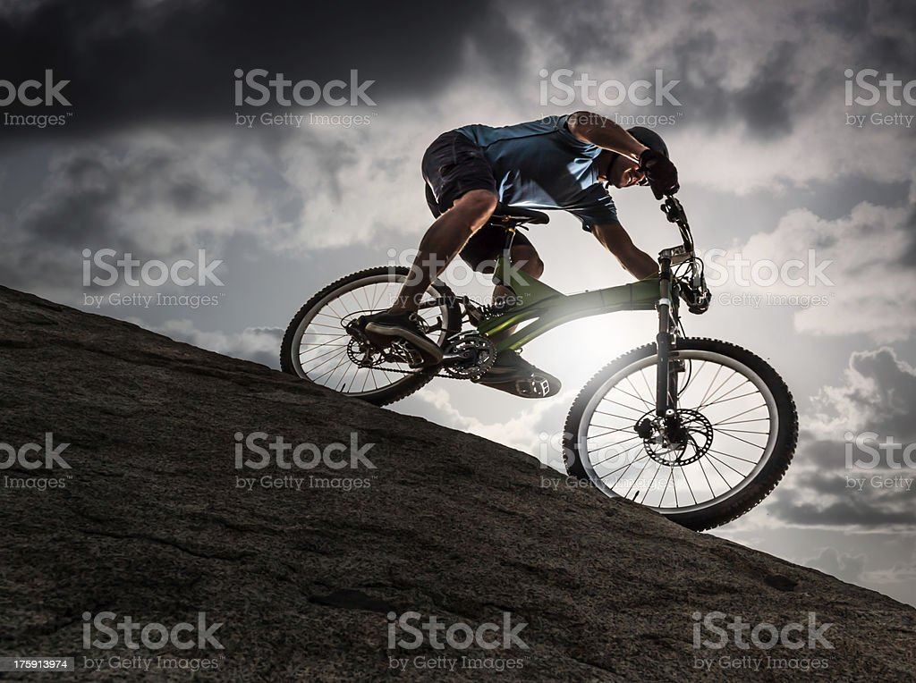 Mountain biker against a dramatic sky royalty-free stock photo