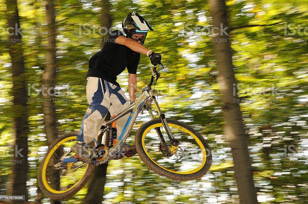 Mountain biker at downhill jump stock photo