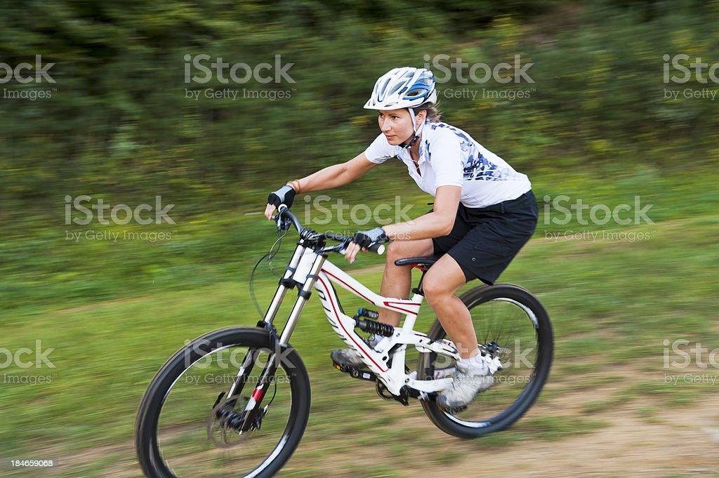 Mountain biker at downhill stock photo