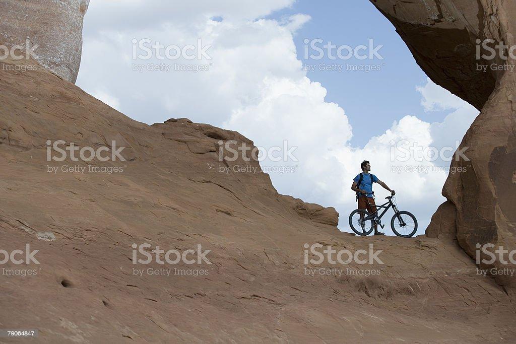 Mountain biker at looking glass rock stock photo