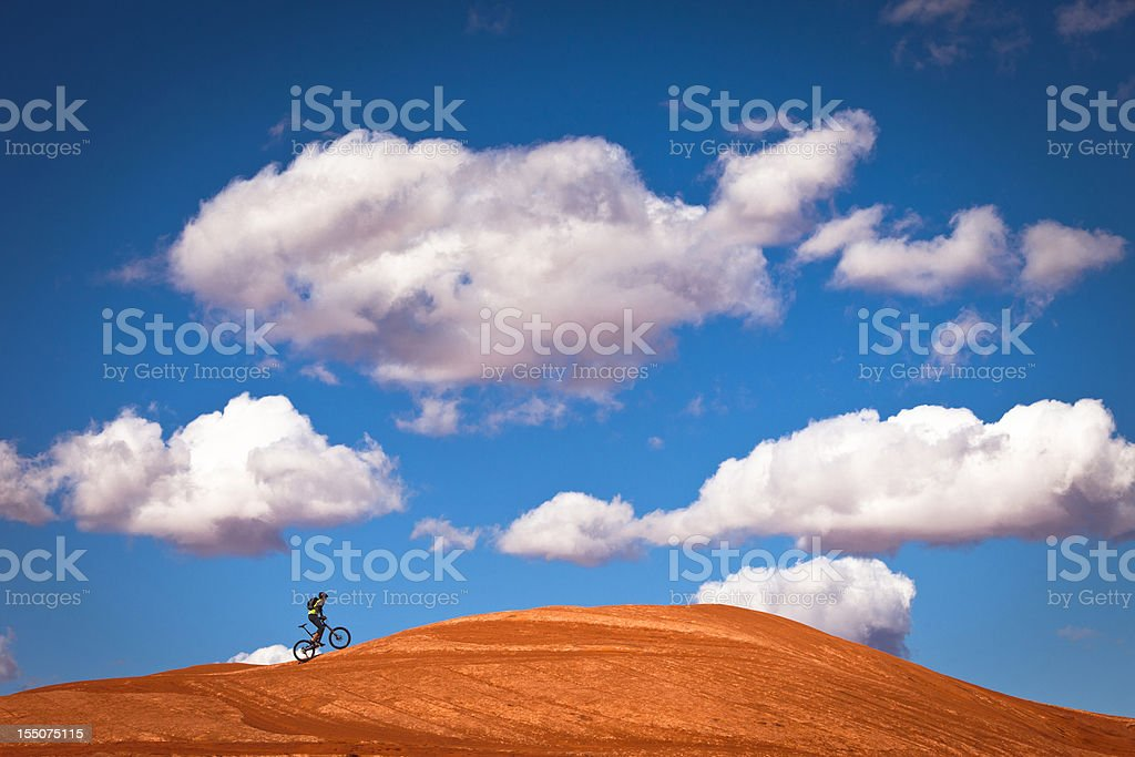 mountain biker climbing on slick rock. stock photo