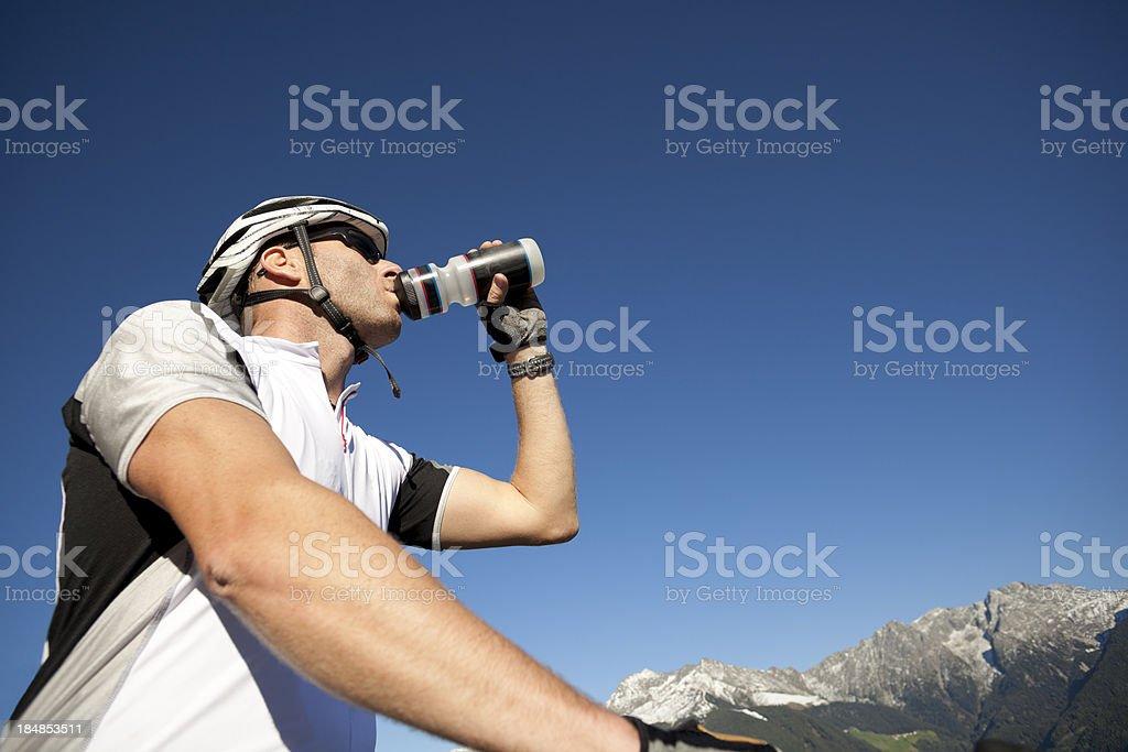 Mountain biker drinking water royalty-free stock photo