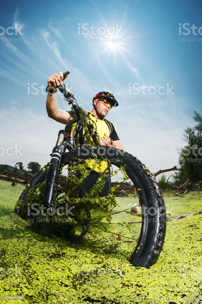 Mountain biker getting out of the swamp royalty-free stock photo