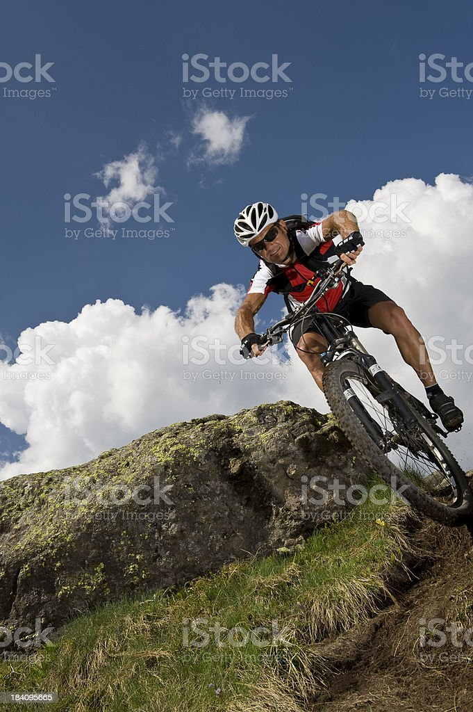 mountain biker in action downhill stock photo
