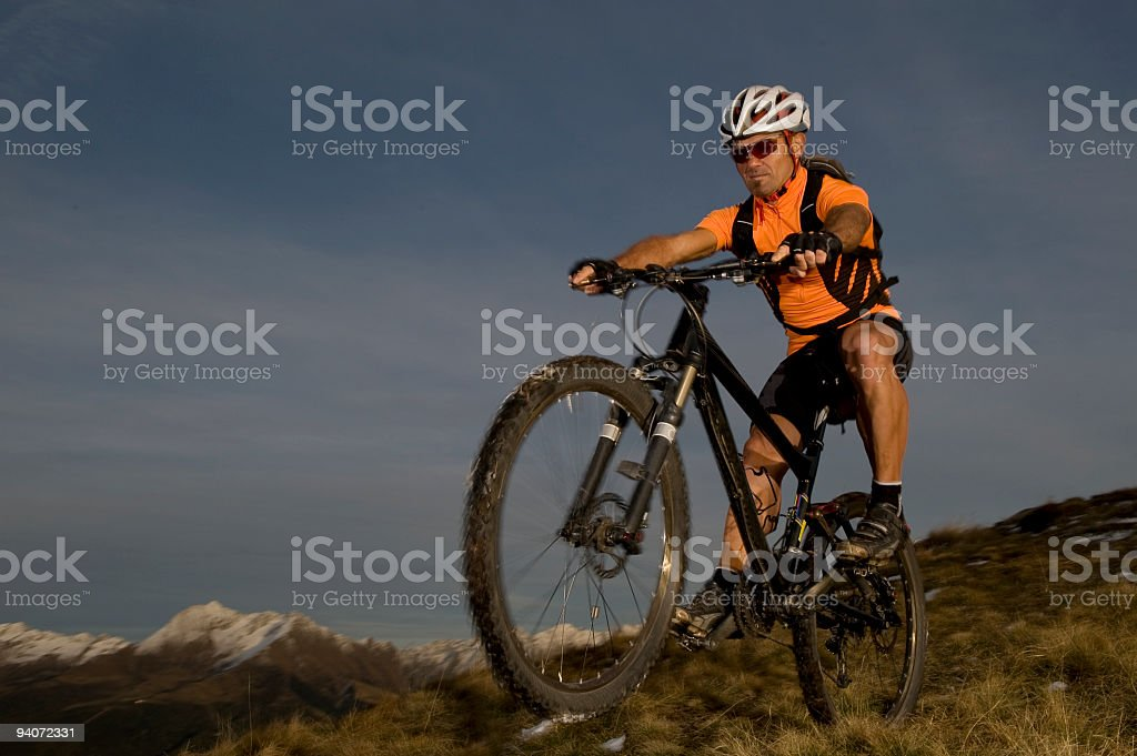 Mountain biker in the evening stock photo