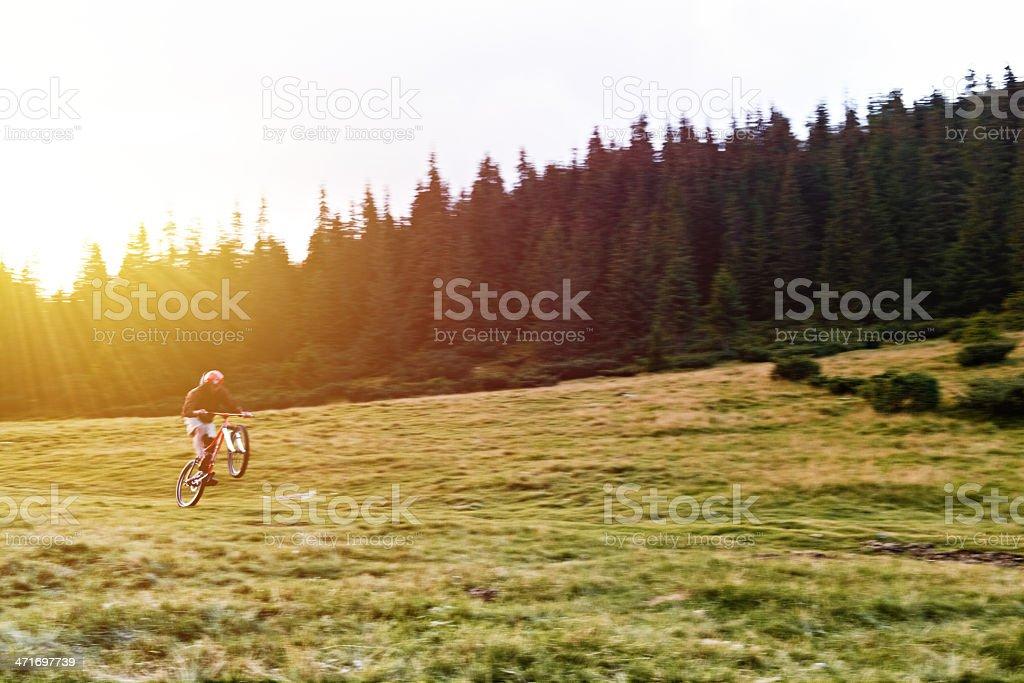 Mountain biker in the field. stock photo