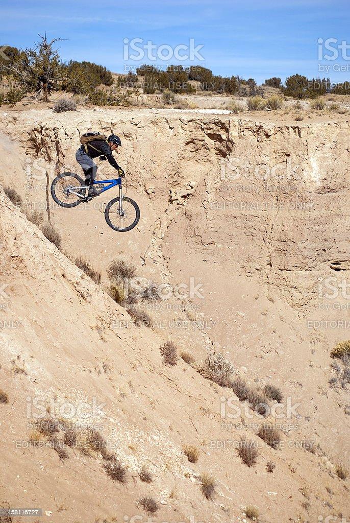 mountain biker jump stock photo